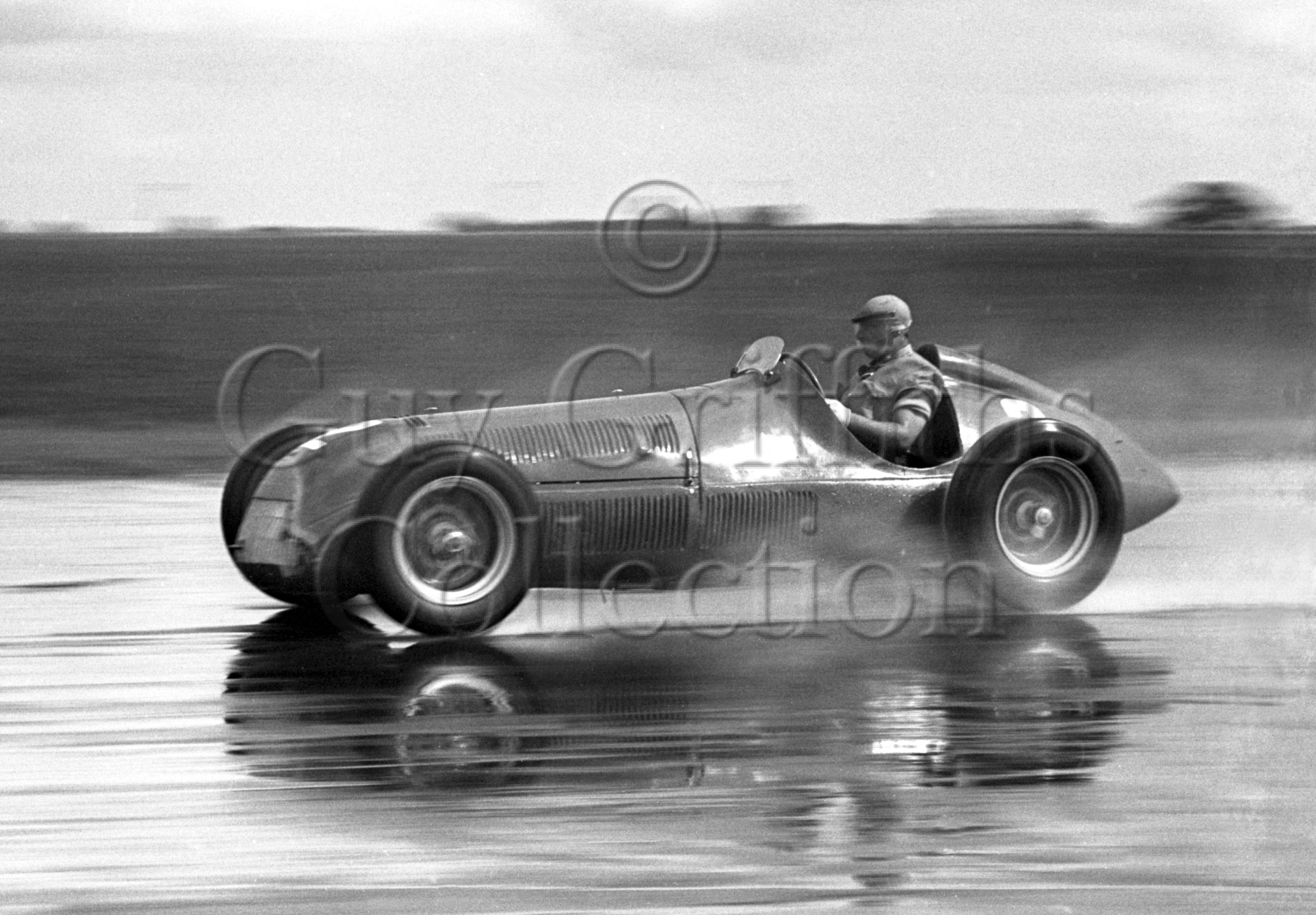 35-946–J-Fangio–Alfa-Romeo–Silverstone–26-08-1950.jpg - The Guy Griffiths Collection